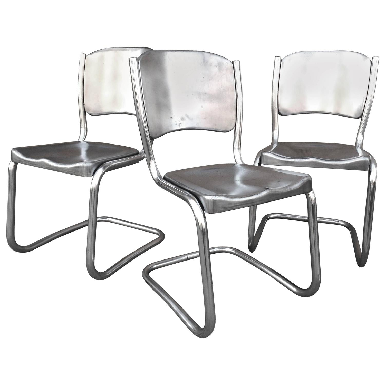 Two Sets of Four Tubular Brushed Steel Dining Chairs For Sale at