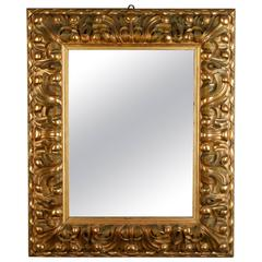 19th Century Italian Mirror with Deeply Carved Gilded Frame