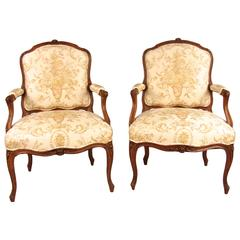 Pair of French Walnut Louis XV Style Armchairs