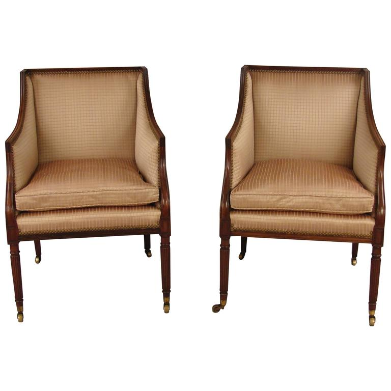 Pair of regency style upholstered arm chairs at stdibs