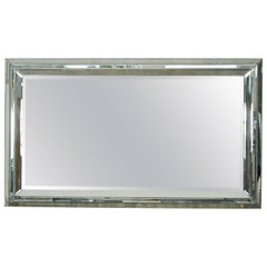 Grand Mirror with a Faceted Mirrored Frame