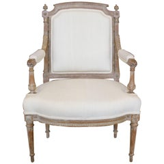 French Louis XVI Style 19th Century Fauteuil with Fluted Accents and Upholstery