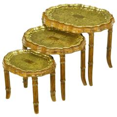 Three Carved Walnut and Etched Brass Tray Nesting Tables