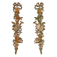 Pair of Tall Painted and Gilded Wall Carvings Depicting Spring and the Arts