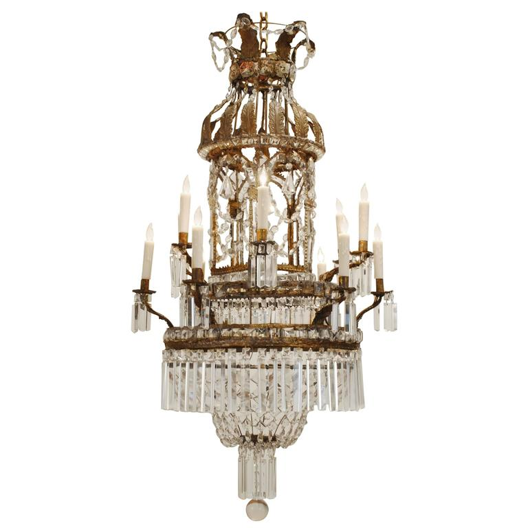 Italian Neoclassical Pressed Brass, Iron and Glass Twelve-Light Chandelier
