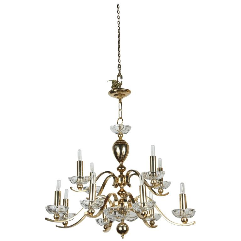 Elegant Twelve-Arm Polished Brass Chandelier For Sale