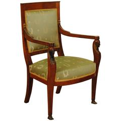 French Empire Carved, Gilded and Ebonized Walnut and Upholstered Fauteuil