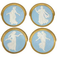 Set of Four Stucco Bas Relief and Gilt Bronze Frame