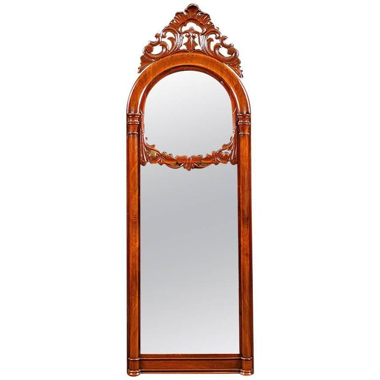 Danish Antique Decorative Arched Mirror in Mahogany w/ a Carved Bonnet and Swag For Sale