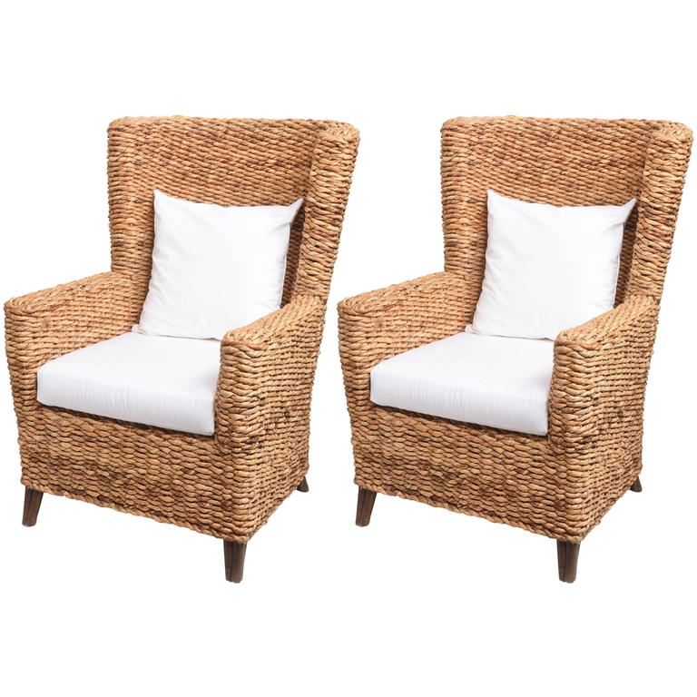 Pair of large woven banana leaf wing chairs at stdibs