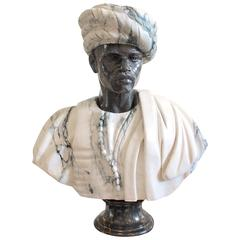Carved Grey Veined and Black Marble Young Blackamoor with Mantle and Turban