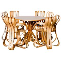 Frank Gehry Face-Off Café Table and Four Cross Check Armchairs