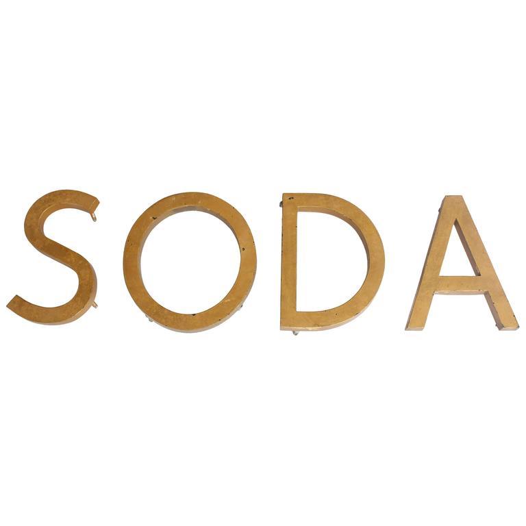 Vintage Gold Leaf Metal Sign Soda