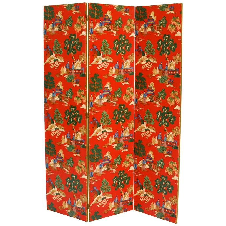 Vintage Chinoiserie red polychrome wallpaper three-panel pagoda screen with beautiful hand painted scenes of mountains and trees. Rich, vibrant color with brass hardware and nails with gilt trim around the edges.