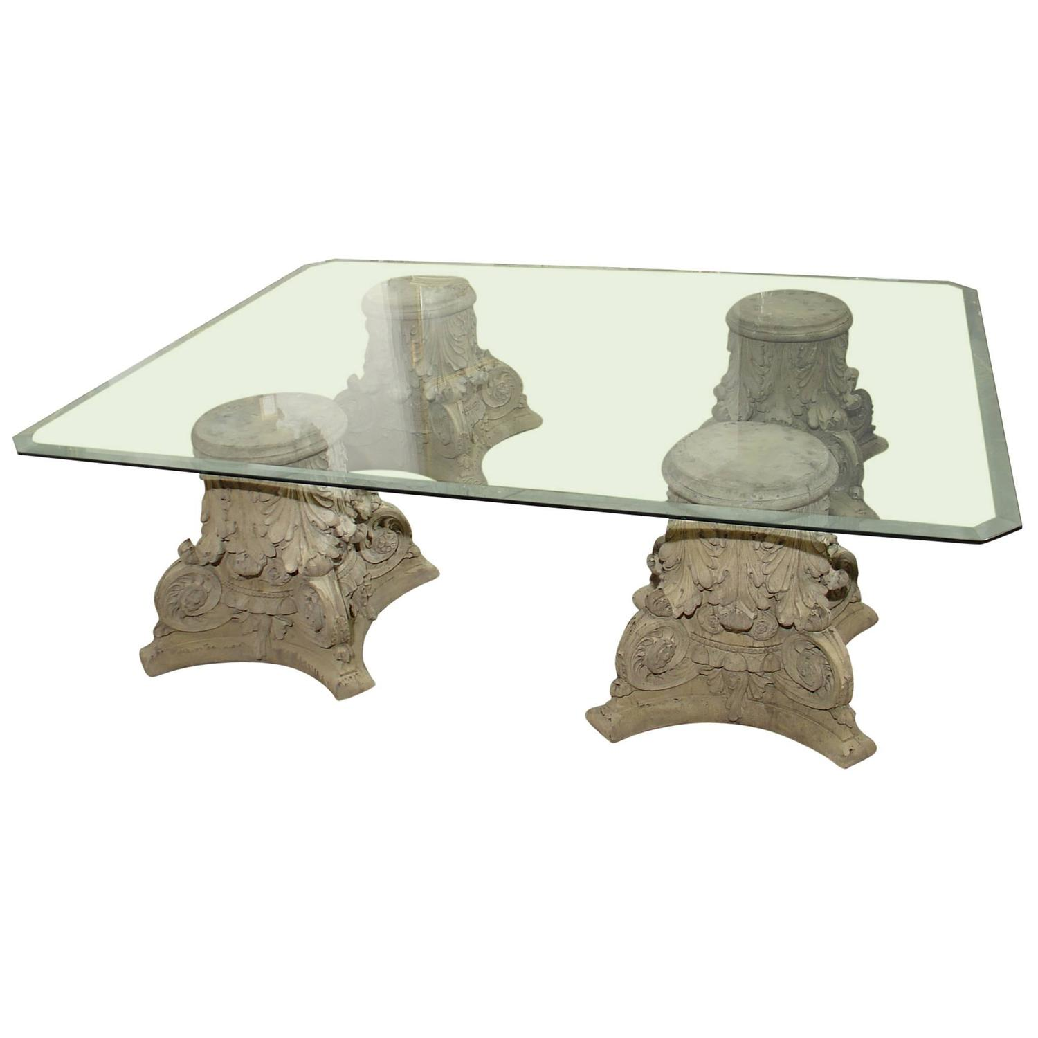 Beveled glass top coffee table on cast stone corinthian capital bases at 1stdibs One of a kind coffee tables