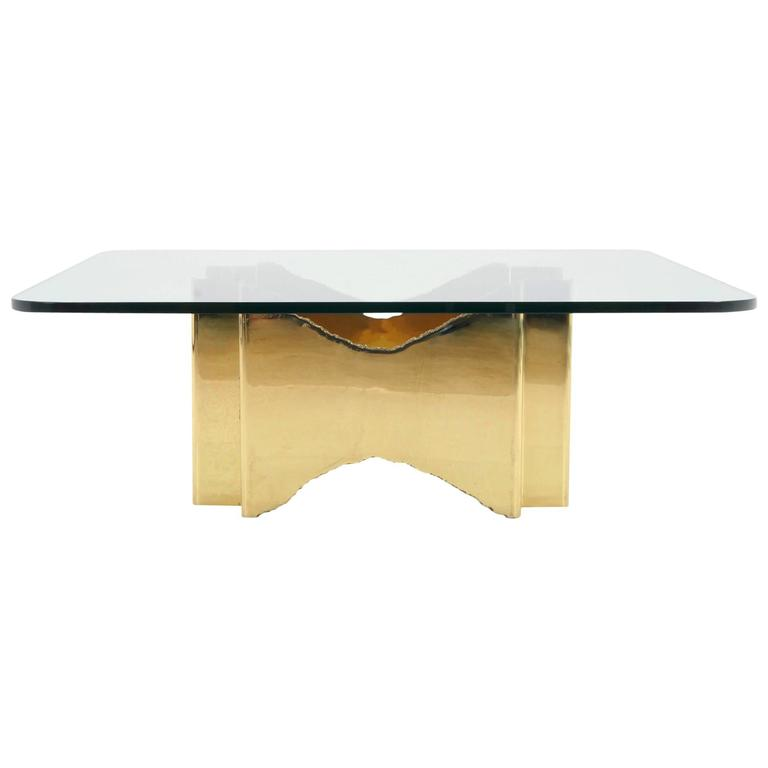 one of a kind brass and glass coffee table with two piece brutalist base at 1stdibs