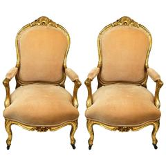 Pair of Louis XV Style Carved Giltwood Amchairs