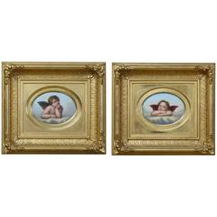 Pair of Porcelain Plaques After Raphael's Cherubs in the Sistine Madonna