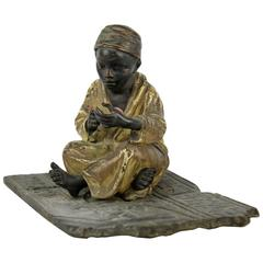 Cold Painted Orientalist Bronze Sculpture of a Seated Arab Boy by F. Bergmann