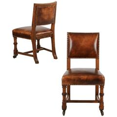 Pair of English Antique Leather and Carved Oak Side Chairs, circa 1900