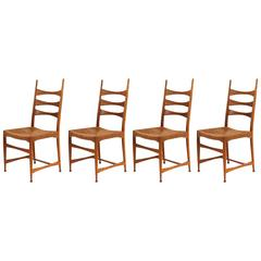 Four Paolo Buffa Sculpted Oak and Raffia Dining Chairs