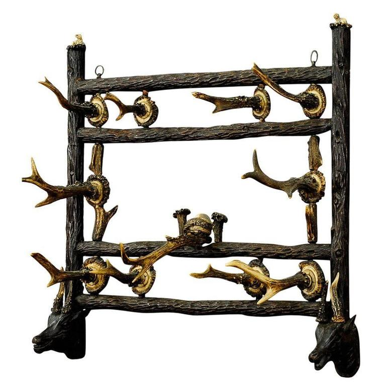 Black Forest Wooden Carved Coat Rack with Antler Carvings, circa 1900