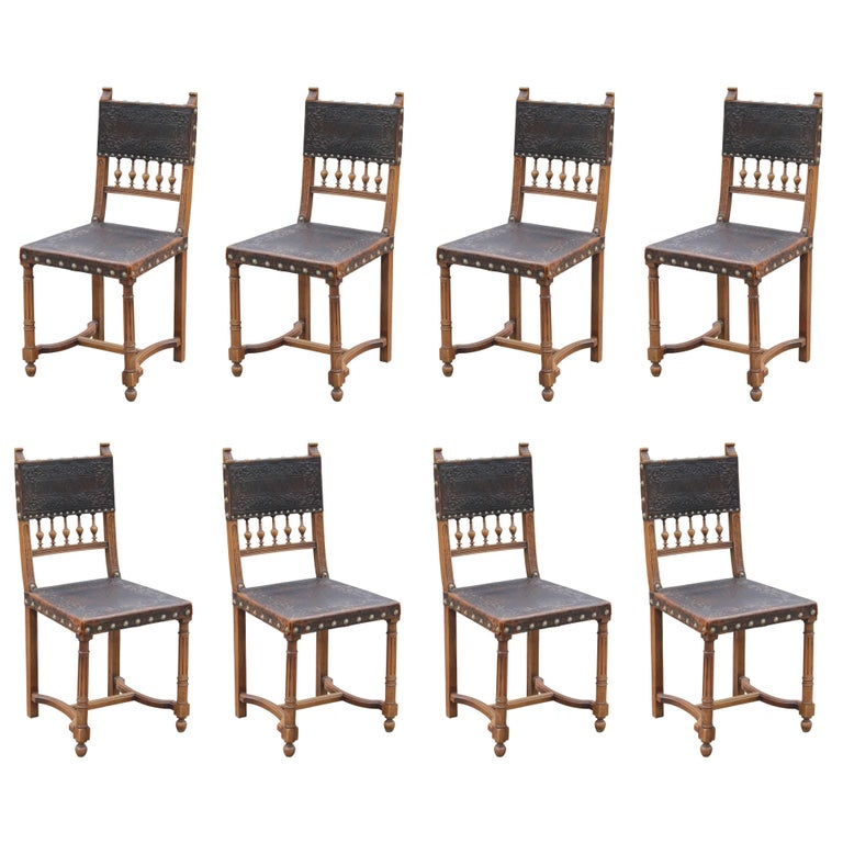 Set of Eight Spanish Brown Embossed Leather Walnut Dining Chairs