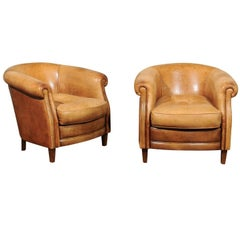 Pair of English Early 20th Century Caramel Leather Club Chairs with Rolled Arms
