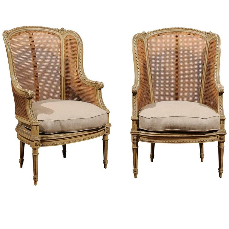 Pair of French Louis XVI Style 1880s Painted Wood and Cane Bergères À Oreilles