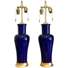 Pair of Cobalt Blue Porcelain Lamps on 23-Karat Water Giltwood Bases
