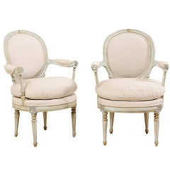 Pair of French Oval-Back Bergère Chairs with Delicately Carved Floral Motifs
