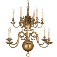 An 18th Century Twelve-Light Dutch Brass Two-Tier Chandelier