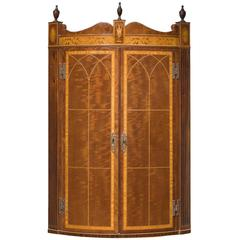 Bow-Fronted Corner Cupboard in the Manner of Thomas Sheraton