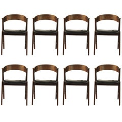 1960s Set of Eight Rosewood Dining Chairs Known as Model 32