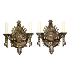 Set of Four Bronze Aztec Motif Sconces