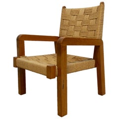 Rare Modernist Bold Oakwood Lounge Chair and Handcrafted Raffia Woven Seating