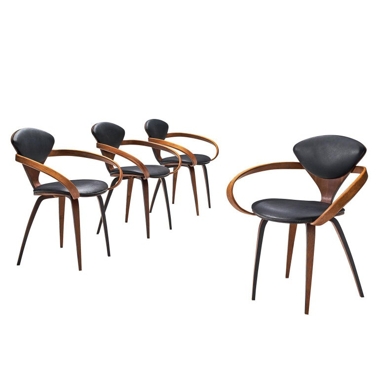 Norman Cherner for Plycraft Four Walnut and Black Leather Dining Chairs
