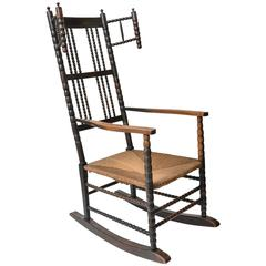 Rocking Chair of Ebonized Rush and Rush Seat Attributed to Ernest Gimson