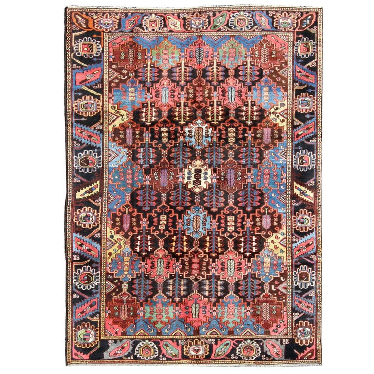Antique Persian Bakhtiari Rug in Charcoal, Brown, Blue, Yellow and Green