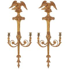 Pair of George III carved gilt-wood twin branch wall lights, late 18th Century