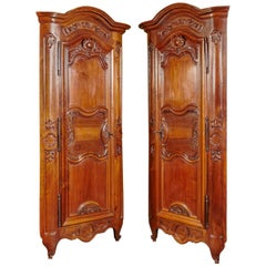 Large Pair of 18th Century Louis XV Carved Walnut Corner Cabinets from Lyon