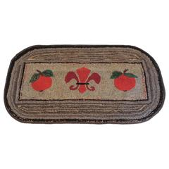 Primitive Oval Hook Rug with Fleur De Lis Centre