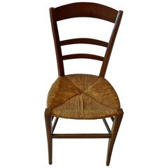 French 19th Century Country Ladder Back Side Chair With Rush Seat.