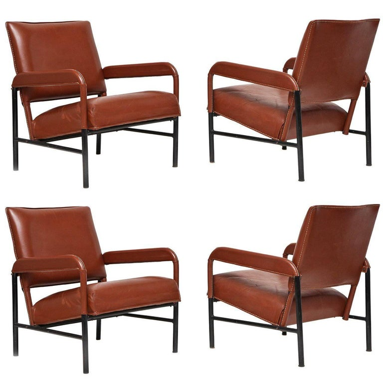 Leather armchairs, ca. 1955, offered by Maison Gerard