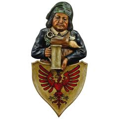 Folk Carved Wall Plaque of a Cellarer with Eagle Crest