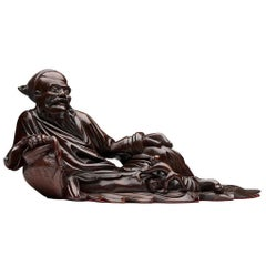 Antique Chinese Hardwood Reclining Immortal Figure, 18th-19th Century