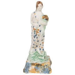 Early Creamware Figure of a Woman Personifying Summer
