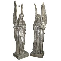 Set of Four Large Silver-Plated Angel Statues