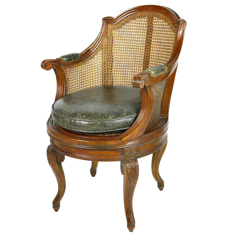 Louis Xv Style Cane And Walnut Swivel Barrel Back Armchair For