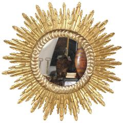French Mid-Century Giltwood Sunburst Mirror with Sunrays of Varying Size